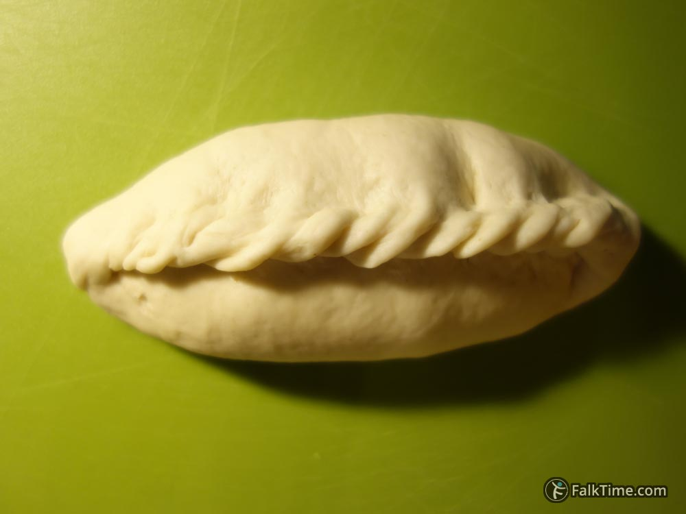 Oval pirozhok with braided seam