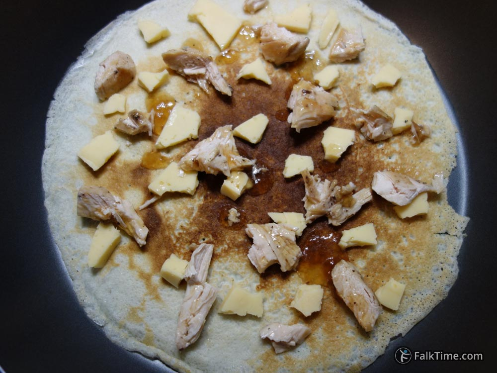 Spread chicken & cheese over pancake