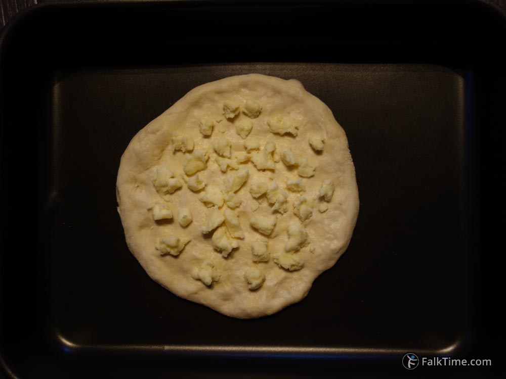 Top khachapuri with some sulguni cheese